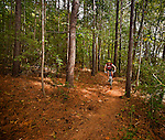 A mountain biker enjoys the trails at the US National Whitewater Center. The Whitewater center is a popular Charlotte attraction.