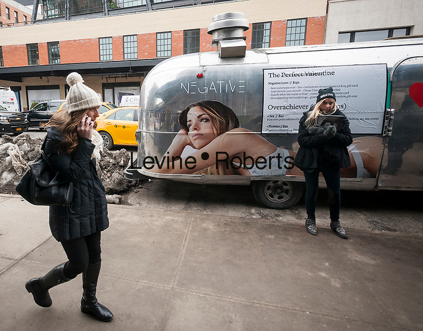 Bundled up visitors to the trendy Meatpacking District in New York walk past an Airstream trailer branded for Negative Underwear, a one-year old lingerie company, on Valentine's Day, Saturday, February 14, 2015. Snow is expected this evening and Sunday is expected to go down to zero, the coldest day in the city in 20 years. (© Richard B. Levine)