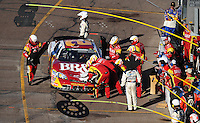 Nov. 8, 2008; Avondale, AZ, USA; NASCAR Nationwide Series driver Clint Bowyer pits to repair damage after a crash during the Hefty Odor Block 200 at Phoenix International Raceway. Mandatory Credit: Mark J. Rebilas-