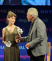 Hay on Wye. Sunday 05 June 2016<br /> Tom Jones (R) receives a flower after speaking about his book 'Over The Top And Back The Autobiography' at the Hay Festival, Hay on Wye, Wales, UK