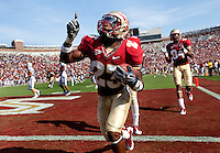 TALLAHASSEE, FL 9/18/10-FSU-BYU FB10 CH-Florida State's Chris Thompson celebrates his 83 yard touchdown run against Brigham Young during first half action Saturday at Doak Campbell Stadium in Tallahassee. .COLIN HACKLEY PHOTO