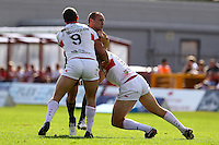 PICTURE BY ALEX WHITEHEAD/SWPIX.COM - Rugby League - Super League - Hull KR vs Wigan Warriors - Craven Park, Hull, England - 02/09/12 - Wigan's Gareth Hock is tackled by Hull KR's Josh Hodgson and Jason Netherton.