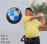 Su Dong (CHN) tees off the 4th tee during Thursday's Round 1 of the 2014 BMW Masters held at Lake Malaren, Shanghai, China 30th October 2014.<br /> Picture: Eoin Clarke www.golffile.ie