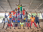 Children form a pyramid as they participate in recreational activities sponsored by Jesuit Refugee Service in the Doro Refugee Camp in Maban, South Sudan. The camp is one of four in Maban that together shelter more than 130,000 refugees from the Blue Nile region of Sudan. The recreational program is one of several psycho-social activities that JRS carries out in the camp.<br /> <br /> Misean Cara supports the work of JRS in the Maban camps.