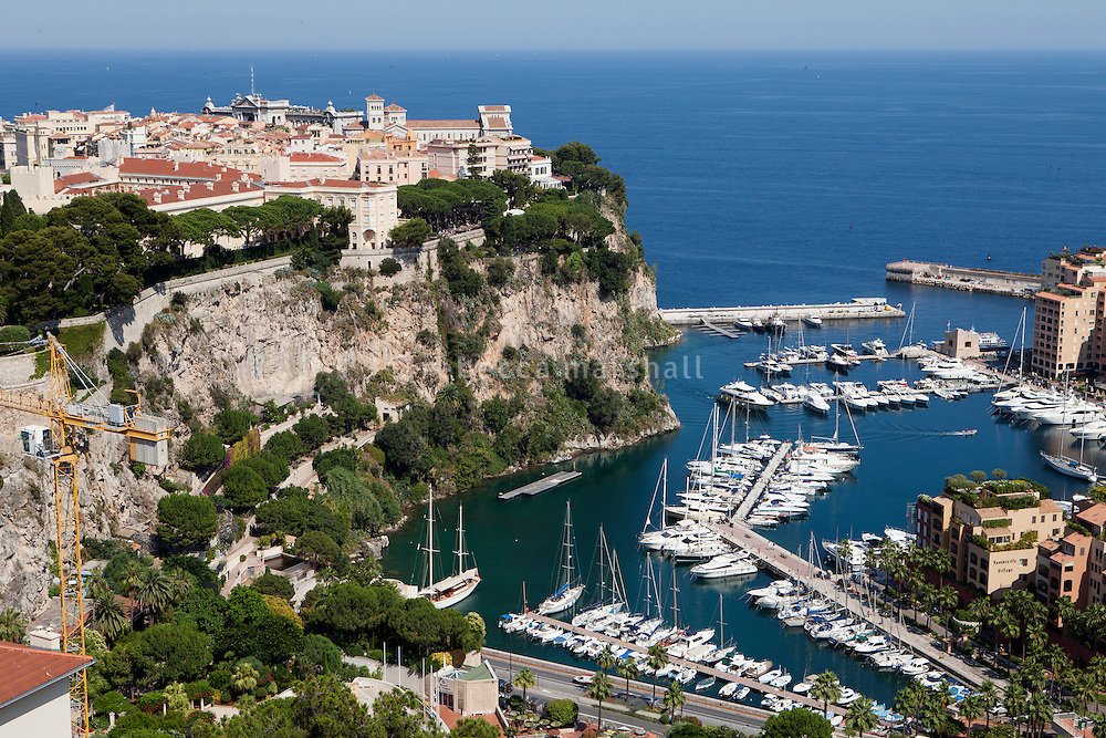 View of Le Rocher [the Rock] of Monaco and Prince's Palace with Fontvielle harbour below as seen from Le Jardin Exotique, Monaco, 5 July 2013