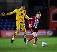 Lincoln City's Anthony Scully vies for possession with Milton Keynes Dons' Carlton Morris<br /> <br /> Photographer Andrew Vaughan/CameraSport<br /> <br /> The EFL Sky Bet League One - Lincoln City v Milton Keynes Dons - Tuesday 11th February 2020 - LNER Stadium - Lincoln<br /> <br /> World Copyright © 2020 CameraSport. All rights reserved. 43 Linden Ave. Countesthorpe. Leicester. England. LE8 5PG - Tel: +44 (0) 116 277 4147 - admin@camerasport.com - www.camerasport.com