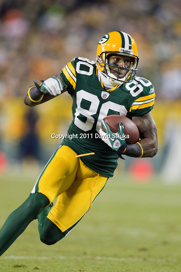 Green Bay Packers wide receiver Donald Driver (80) carries the ball during a week 16 NFL football game against the Chicago Bears on December 25, 2011 in Green Bay, Wisconsin. The Packers won 35-21. (AP Photo/David Stluka)