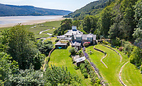 BNPS.co.uk (01202 558833)<br /> Pic: WalterLloydJones/BNPS<br /> <br /> Famous explorers Snowdonia home for sale...<br /> <br /> The former home of 'Boys Own' hero Maj Bill Tilman, with spectacular views across an estuary to Snowdonia, has come on the market for £1.35 million.<br /> <br /> The war hero, mountaineer, yachtsman and novelist lived in the idyllic home for many years untill his mysterious disapearance in the South Atlantic in 1977.<br />  <br /> In the 1930s Major Harold William Tilman conducted inspection missions at Mount Everest, reaching 27,000ft without oxygen.<br />  <br /> His work helped gather information for Sir Edmund Hillary and Tenzing Norgay's record-breaking ascent in 1953.<br />  <br /> Maj Tilman, who served at The Somme in the First World War and fought in World War Two aged in his 40s, wrote about his adventures from the library of his Snowdonia home.