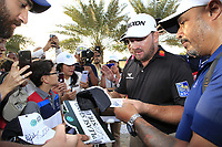Graeme McDowell (NIR) signing autographs after the final round of  the Saudi International powered by Softbank Investment Advisers, Royal Greens G&CC, King Abdullah Economic City,  Saudi Arabia. 02/02/2020<br /> Picture: Golffile | Fran Caffrey<br /> <br /> <br /> All photo usage must carry mandatory copyright credit (© Golffile | Fran Caffrey)