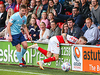 Fleetwood Town's Ashley Hunter ends up over the advertising boards after a challenge from Accrington Stanley's Sam Finley<br /> <br /> Photographer Alex Dodd/CameraSport<br /> <br /> The EFL Sky Bet League One - Fleetwood Town v Accrington Stanley - Saturday 15th September 2018  - Highbury Stadium - Fleetwood<br /> <br /> World Copyright &copy; 2018 CameraSport. All rights reserved. 43 Linden Ave. Countesthorpe. Leicester. England. LE8 5PG - Tel: +44 (0) 116 277 4147 - admin@camerasport.com - www.camerasport.com