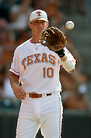 Texas Longhorn shortstop Brandon Loy #10 warms up before the game against the Arizona State Sun Devils  in NCAA Tournament Super Regional Game #3 on June 12, 2011 at Disch Falk Field in Austin, Texas. (Photo by Andrew Woolley / Four Seam Images)