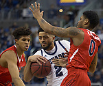 Nevada  guard Jalen Harris (2) drives past the Fresno State defense during the first half of a basketball game played at Lawlor Events Center in Reno, Nev., Saturday, Feb. 22, 2020.