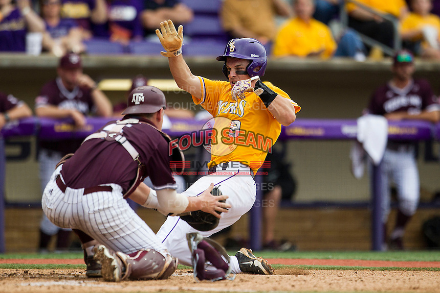 LSU Tigers shortstop Alex Bregman (8) slides home as Texas A&M catcher Michael Barash (5) attempts to tag him during the Southeastern Conference baseball game on April 25, 2015 at Alex Box Stadium in Baton Rouge, Louisiana. Texas A&M defeated LSU 6-2. (Andrew Woolley/Four Seam Images)