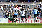 Georginio Wijnaldum of Newcastle United sends Tottenham's Hugo Lloris the wrong way with his penalty for his sides third goal during the Barclays Premier League match at St James' Park. Photo credit should read: Philip Oldham/Sportimage