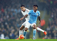 Raheem Sterling of Manchester City and Jack Cork of Swansea City during the Barclays Premier League match between Manchester City and Swansea City played at the Etihad Stadium, Manchester on December 12th 2015