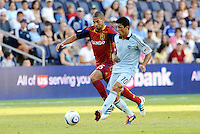 Sporting KC midfielder Jeferson pursued by Alvaro Saboria Real Salt Lake... Sporting Kansas City defeated Real Salt Lake 2-0 at LIVESTRONG Sporting Park, Kansas City, Kansas.