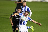 Tom Lapslie of Colchester United holds off Callum O'Hare of Aston Villa during Colchester United vs Aston Villa, Caraboa Cup Football at the Weston Homes Community Stadium on 9th August 2017