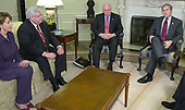 United States President George W. Bush, right, and US Vice President Dick Cheney, right center, wait to begin a meeting with bipartisan members of Congress in the Oval Office of the White House March 21, 2003 in Washington, DC. US  House Minority Leader Nancy Pelosi (Democrat of California), left, and Speaker of the US House Dennis Hastert (Republican of Illinois), left center, joined the meeting to discuss the war in Iraq. <br /> Credit: Mike Theiler - Pool via CNP