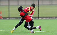 Pictured: Ki Sung Yeung wrestles Nathan Dyer in training today<br /> Swansea City Football Training, Swansea, 07/03/13