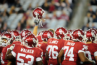 Jan. 1, 2011; Glendale, AZ, USA; Oklahoma Sooners players huddle prior to the game against the Connecticut Huskies in the 2011 Fiesta Bowl at University of Phoenix Stadium. Mandatory Credit: Mark J. Rebilas-