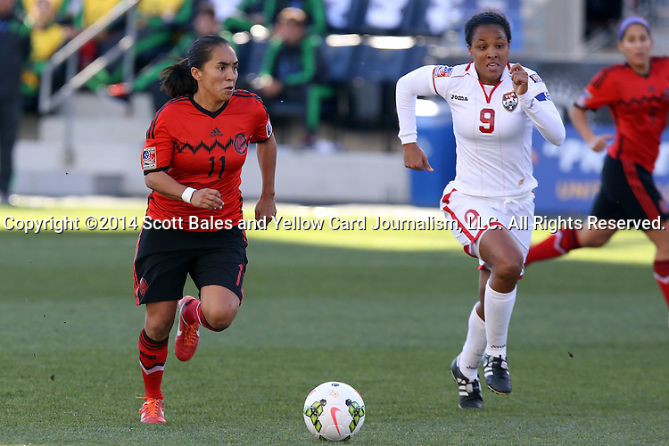 26 October 2014: Monica Ocampo (MEX) (11) and Maylee Attin (TRI) (9). The Trinidad & Tobago Women's National Team played the Mexico Women's National Team at PPL Park in Chester, Pennsylvania in the 2014 CONCACAF Women's Championship Third Place game. Mexico won the game 4-2 after extra time. With the win, Mexico qualified for next year's Women's World Cup in Canada and Trinidad & Tobago face playoff for spot against Ecuador.