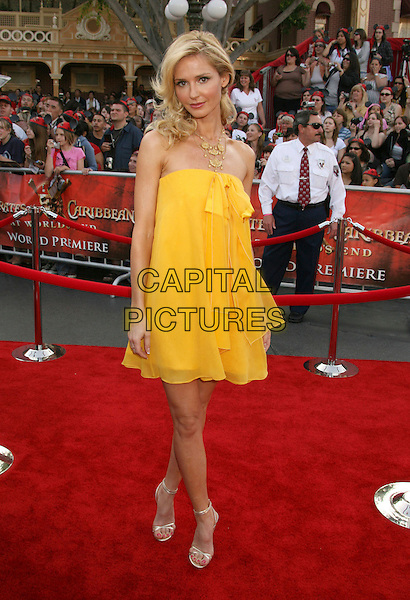 "VANESSA BRANCH.""Pirates Of The Caribbean: At World's End"" World Premiere held at Disneyland, Anaheim, California, USA,.May 19th, 007.3 full length yellow strapless dress .CAP/ADM/RE.©Russ Elliot/AdMedia/Capital Pictures"