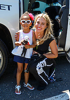Jun 12, 2016; Englishtown, NJ, USA; NHRA top fuel driver Brittany Force (right) poses for a photo with a young female fan during the Summernationals at Old Bridge Township Raceway Park. Mandatory Credit: Mark J. Rebilas-USA TODAY Sports