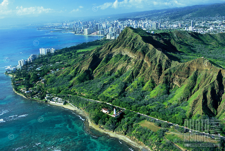 Aerial over Diamond Head, the coastline  and the Lighthouse l ooking toward Waikiki and Honolulu, Hawaii