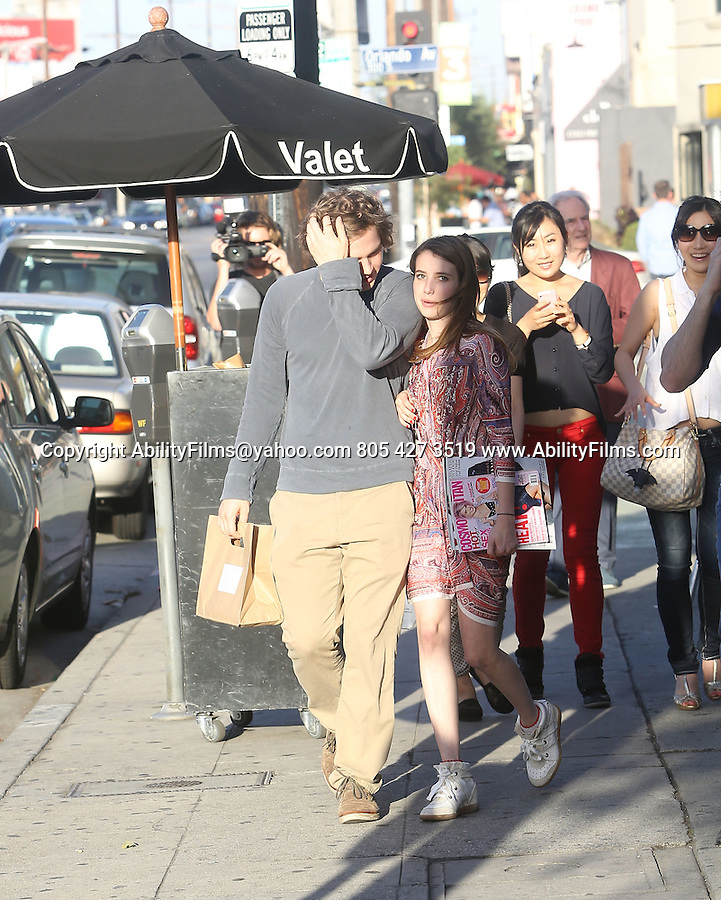 May 28th 2013<br />  <br /> Emma Roberts laughing smiling holding hands with her boyfriend Evan Peters<br /> Carrying a Cosmopolitan magazine. The couple ate lunch at Joans on Third in West Hollywood . Emma was wearing big white sneakers tennis shoes &amp; red purple dress pink purse .<br />  <br /> AbilityFilms@yahoo.com<br /> 805 427 3519<br /> www.AbilityFilms.com