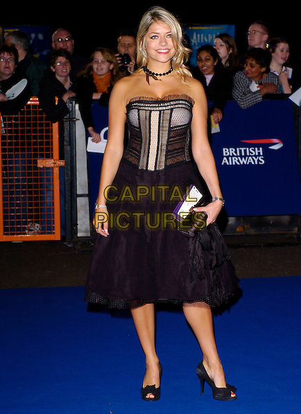HOLLY WILLOUGHBY.National Television Awards 2005 at the Royal Albert Hall. London, UK.October 25th 2005.Ref: CAP/JH.full length black strapless lace silk satin dress holding matching clutch bag black beads choker necklace peep toe shoes heels.www.capitalpictures.com.sales@capitalpictures.com.© Copyright 2005 Adrian Seal, Photoscene.biz Midtownstudios 50 Acton Mews,London E84EA Tel:07973673832 .