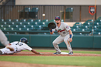 Fort Myers Miracle first baseman Robby Rinn (11) waits to receive a pick off throw as Derek Hill (18) dives back into first base during a game against the Lakeland Flying Tigers on August 7, 2018 at Publix Field at Joker Marchant Stadium in Lakeland, Florida.  Fort Myers defeated Lakeland 5-0.  (Mike Janes/Four Seam Images)