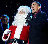 United States President Barack Obama sings with Santa Claus during the 2011 National Christmas Tree Lighting on the Ellipse in Washington, DC, on Thursday, December 1, 2011.  .Credit: Roger L. Wollenberg / Pool via CNP