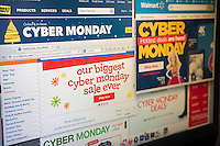 A collection of websites touting their Cyber Monday sales on Monday, December 1, 2014. Black Friday promotions that lasted all last week combined with online deals all season round have stretched out and diluted the holiday shopping weekend.  While many retailers are offering specials online for Cyber Monday, the so-called holiday dates back when most Americans had no broadband and limited internet access so they would shop on the first day back at work, using their employers faster internet. (© Richard B. Levine)