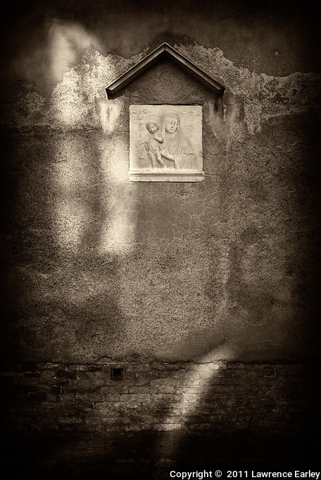 A charming relief on the exterior of the church in Campo San Polo, Venice.