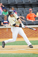 Matt Conway (25) of the Wake Forest Demon Deacons fouls the ball off his foot during the game against the Virginia Cavaliers at Wake Forest Baseball Park on May 17, 2014 in Winston-Salem, North Carolina.  The Demon Deacons defeated the Cavaliers 4-3.  (Brian Westerholt/Four Seam Images)