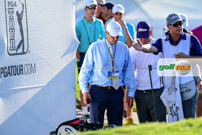Tom Hoge (USA) and a rules official discuss Hoge's drop on 9 after his approach shot ended up near the bleachers during the round 2 of the Dean &amp; Deluca Invitational,  Colonial Country Club, Ft. Worth, Texas, USA. 5/27/2016.<br /> Picture: Golffile | Ken Murray<br /> <br /> <br /> All photo usage must carry mandatory copyright credit (&copy; Golffile | Ken Murray)