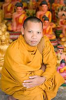 Monk with Buddhas.