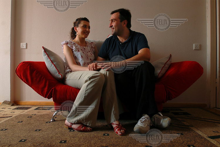 35 year old IT technician Georgi Chachkhunashvili and his new wife 25 year old Sophio Sophromadze in the kitchenette of their Tbilisi apartment.