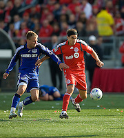26 April 2009: Toronto FC forward Pablo Vitti #8 and Kansas City Wizards defender Michael Harrington #2 in action at BMO Field in Toronto in a  game between Kansas City Wizards and Toronto FC..Toronto FC won 1-0.