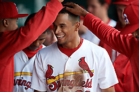 Springfield Cardinals center fielder Oscar Mercado (26) is congratulated by his teammates in the dugout after scoring a run during a game against the Corpus Christi Hooks on May 31, 2017 at Hammons Field in Springfield, Missouri.  Springfield defeated Corpus Christi 5-4.  (Mike Janes/Four Seam Images)