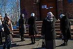 Women pray outside a church after services on Sunday, October 20, 2013 in Baikalsk, Russia.