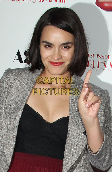 "Shannyn Sossamon.""A Glimpse Inside The Mind of Charles Swan III"" Los Angeles Premiere held at ArcLight Cinemas, Hollywood, California, USA..February 4th, 2013.half length blazer black grey gray top red skirt lipstick hand finger arm.CAP/ADM/RE.©Russ Elliot/AdMedia/Capital Pictures."