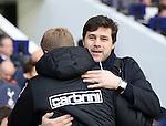 Tottenham's Mauricio Pochettino hugs Bournemouth's Eddie Howe  during the Premier League match at White Hart Lane Stadium.  Photo credit should read: David Klein/Sportimage