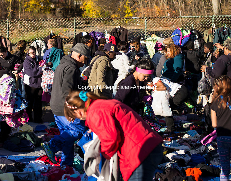 Waterbury, CT- 19 November 2016-111916CM07- Throngs of people pick out clothes during a Thanksgiving Outreach in Martin Luther King Park in Waterbury on Saturday.  The event put on by Christ Church, provided food, clothing items and blankets.  Christopher Massa Republican-American