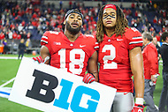 Indianapolis, IN - December 1, 2018: Ohio State Buckeyes defensive end Chase Young (2) and Ohio State Buckeyes defensive end Jonathon Cooper (18) celebrates after the Big Ten championship game between Northwestern  and Ohio State at Lucas Oil Stadium in Indianapolis, IN.   (Photo by Elliott Brown/Media Images International)