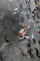 Demonstrators on Khosh Street set light to a car and throw missiles. Following a disputed election result, thousands of supporters of opposition candidate Mir-Hossein Mousavi took to the streets in protest.