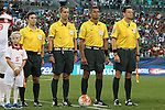 15 July 2015: Match officials. From left: Assistant Referee Eric Boria (USA), Referee Mark Geiger (USA), Fourth Official John Pitti (PAN), Assistant Referee Peter Manikowski (USA). The Mexico Men's National Team played the Trinidad & Tobago Men's National Team at Bank of America Stadium in Charlotte, NC in a 2015 CONCACAF Gold Cup Group C match. The game ended in a 4-4 tie.