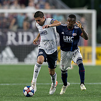 FOXBOROUGH, MA - JUNE 27: Alejandro Bedoya #11 dribbles as Luis Caicedo #27 defends during a game between Philadelphia Union and New England Revolution at Gillette Stadium on June 27, 2019 in Foxborough, Massachusetts.