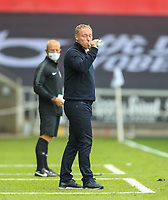 18th July 2020; Liberty Stadium, Swansea, Glamorgan, Wales; English Football League Championship, Swansea City versus Bristol City; Steve Cooper manager of Swansea City drinks water during the match