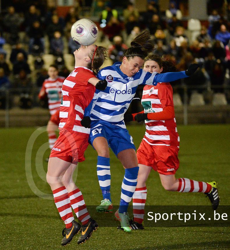 20140221 - OOSTAKKER , BELGIUM : Antwerp Stefanie Van Broeck (l) pictured in a duel with Gent Kay Cuvelier (r) during the soccer match between the women teams of AA Gent Ladies  and RAFC Antwerp Ladies , on the 19th matchday of the BeNeleague competition Friday 21 February 2014 in Oostakker. PHOTO DAVID CATRY